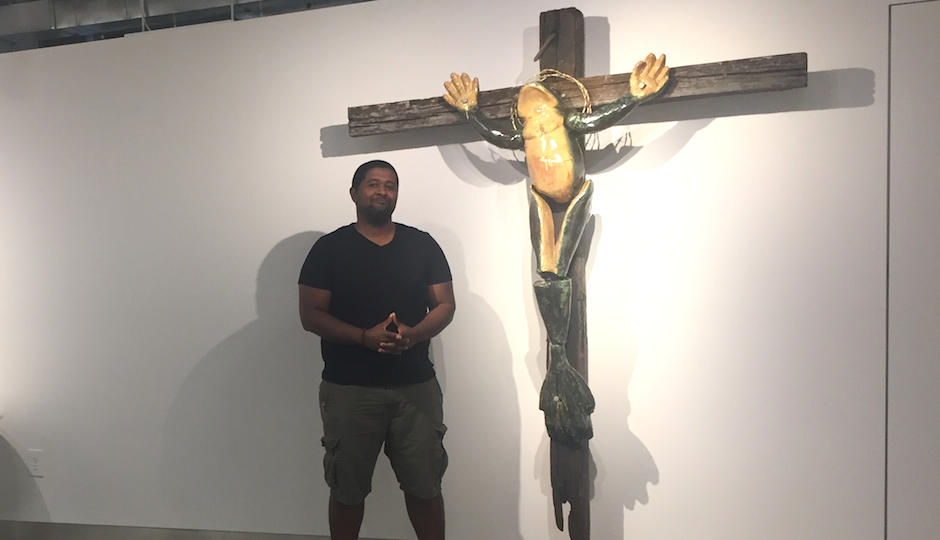 Artist Ashaundei Smith and his crucified frog sculpture at Penn State Abington, where the artwork is the talk of the campus.