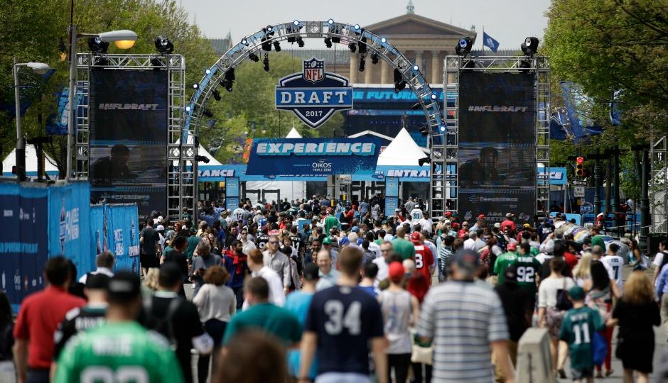Fans arrive ahead of the 2017 NFL football draft, in Philadelphia, Thursday, April 27, 2017. (AP Photo/Matt Rourke)