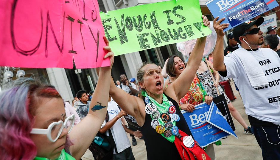 Bernie Sanders supporters protest at City Hall during the DNC on July 28, 2016. Photo: John Minchillo/AP