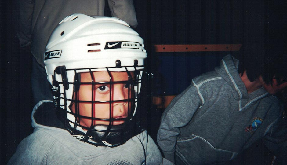 Bobby in hockey gear around age 9. Photograph courtesy of the Hill family.